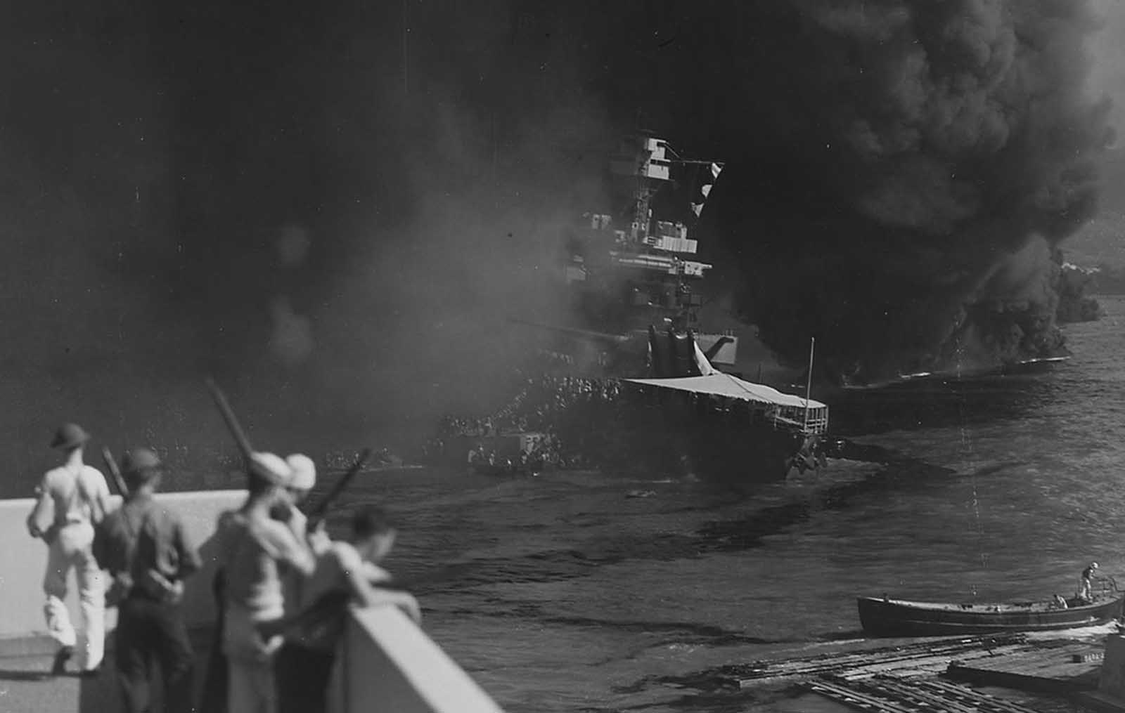 The USS California sinks into the mud of Pearl Harbor on December 7, 1941.