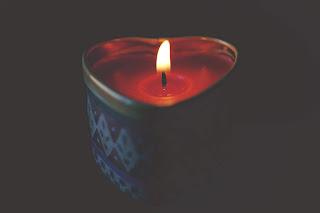 https://www.pexels.com/photo/close-up-of-tea-light-candle-against-black-background-321444/