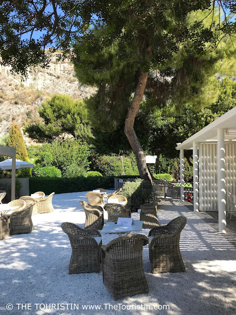 Cafe and restaurant under trees at Lake Vouliagmeni near Athens in Greece