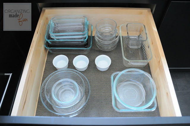 Organized drawer of glass left over containers :: OrganizingMadeFun.com