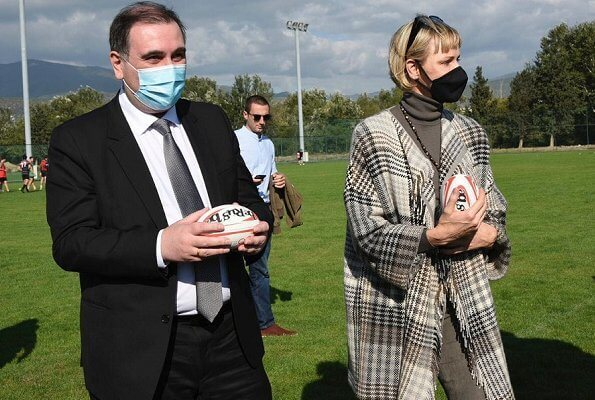 Princess Charlene visited the Olympic Village in Tbilisi and its sports facilities. Charlene wore a traford plaid fringe poncho from Loro Piana