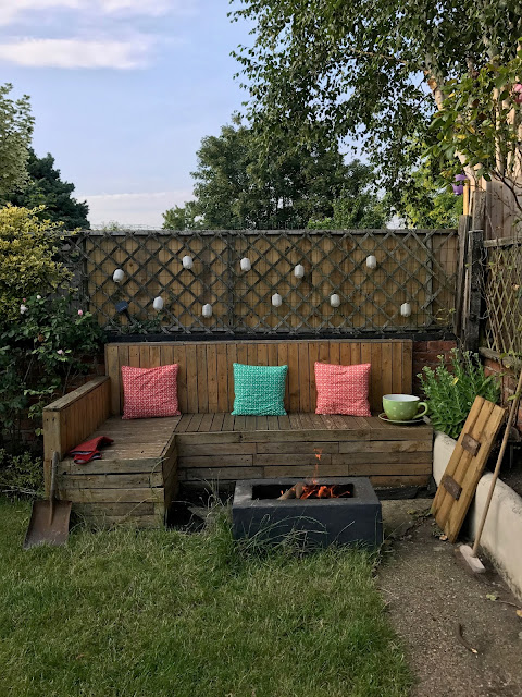 Pallet Seating with Fire Pit in Garden