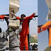ISIS stabs and shoots man in public after crucifying him (Graphic Photos)