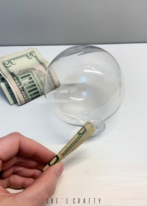 How to gift money for Christmas - ornament filled with bills