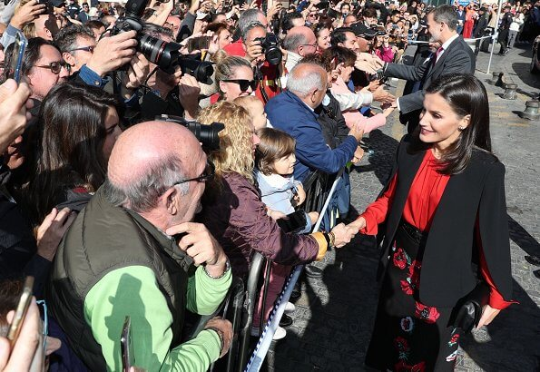 Queen Letizia wore Zara cape style jacket in black and Hugo Boss Banora gathered silk blouse and black floral skirt