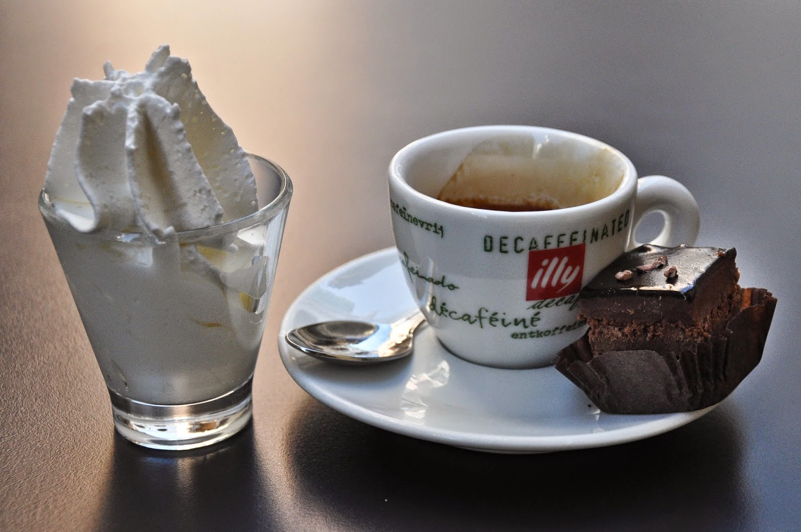 Espresso with a pot of whipped cream and an elegant sweet bite, Vicenza, Italy