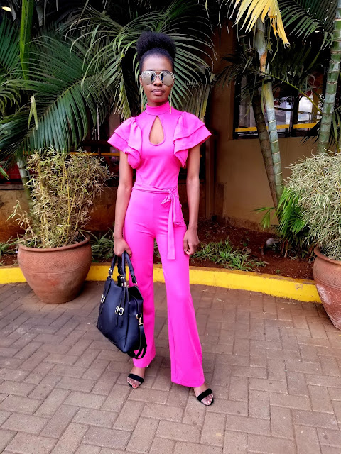 How To Pull Of A Jumpsuit That's Bright Pink