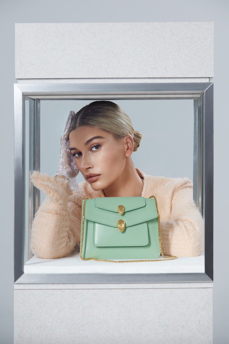 Hailey Baldwin poses with Serpenti Forever bag for Alexander Wang x Bulgari campaign