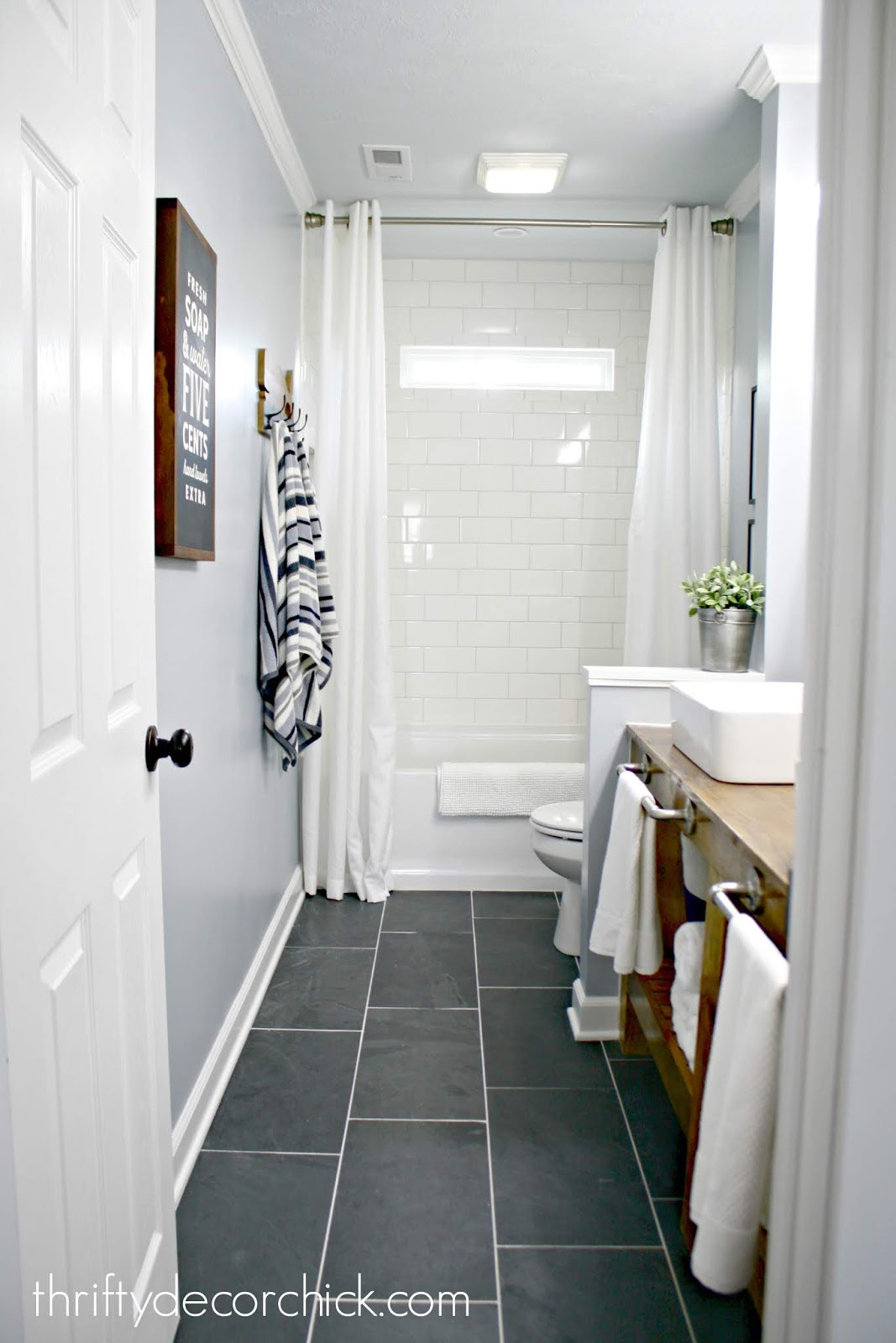 Bathroom makeover gray tile subway shower wood vanity