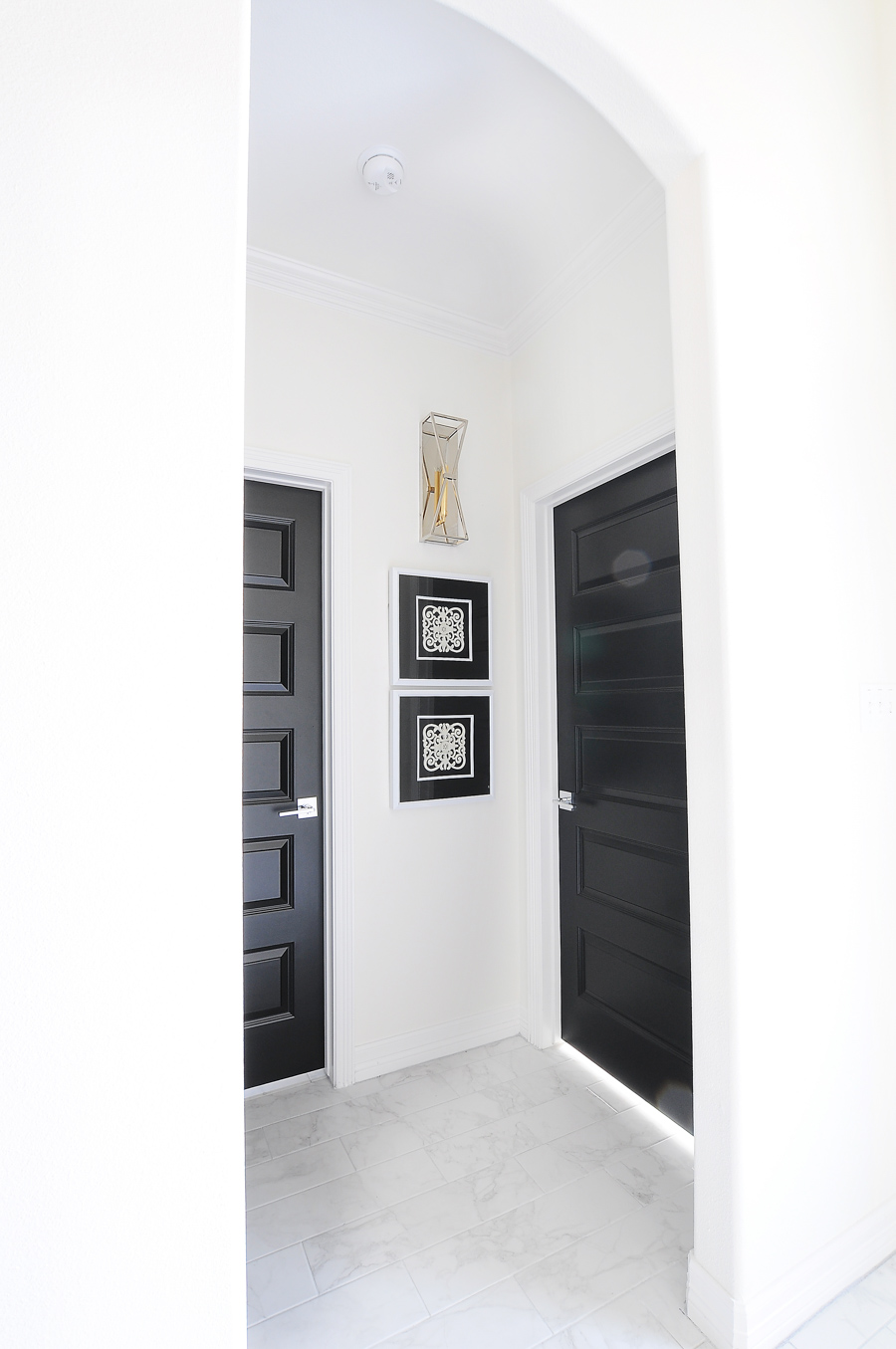 Black interior doors in a gorgeous satin finish look sleek when paired with minimal decor and alabaster white walls.
