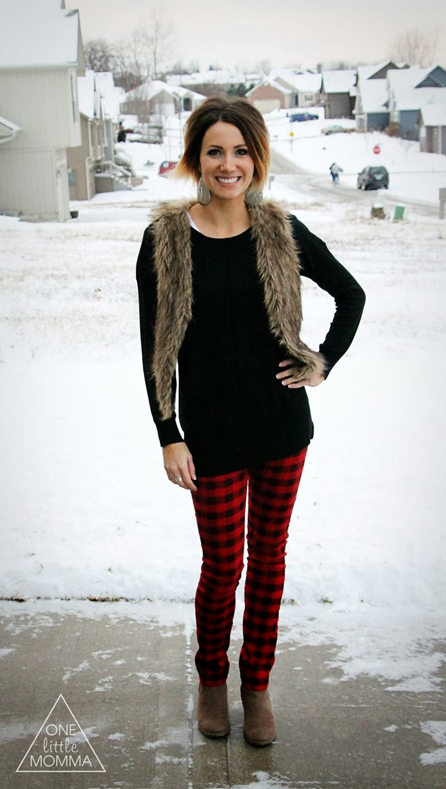 Tone down plaid pants with chic basics like a fur vest, black sweater and neutral ankle boots