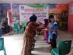 Babinsa Koramil 1509-01/Bacan Dampingi Pemdes Tuwokona Bagikan BLT-DD