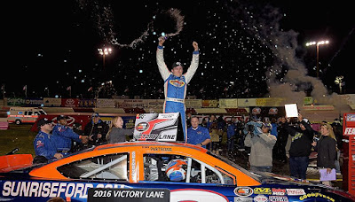 Ryan Partridge celebrated in Victory Lane following his third win of the season at All American Speedway in Roseville, California, on Saturday night. Jonathan Moore/NASCAR via Getty Images