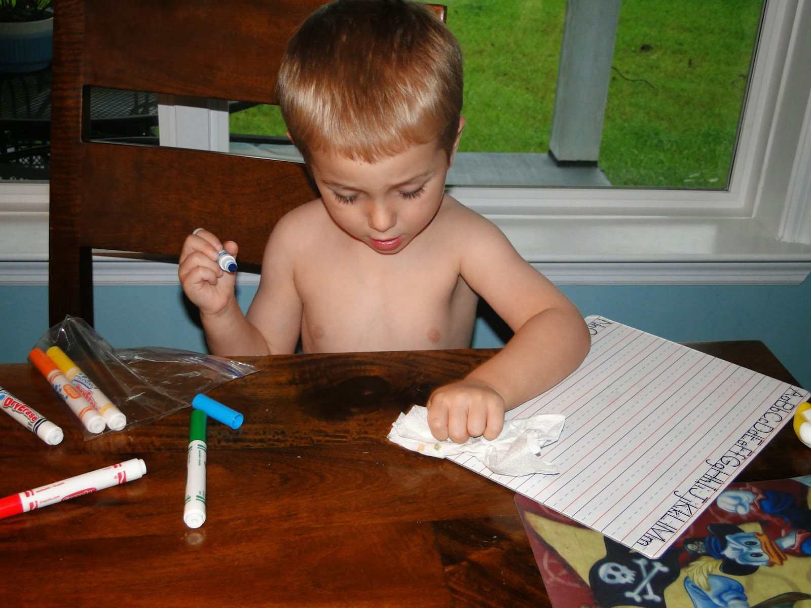 boy practicing writing