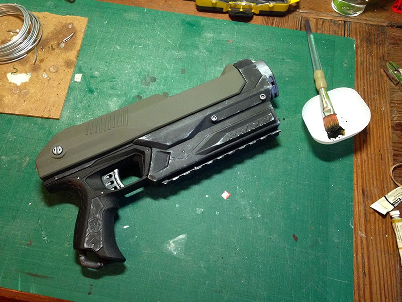 Brushing watery black acrylic over the gun