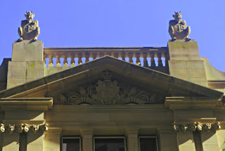 Gargoyles on the parapet over George Street, Brisbane. Four small devil faces can be seen below these.
