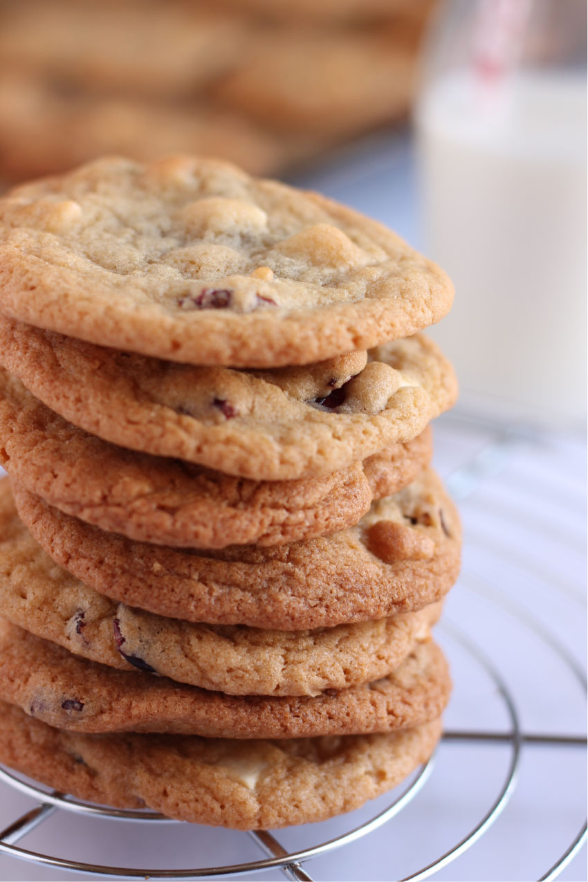 A stack of white chocolate and cranberry cookies