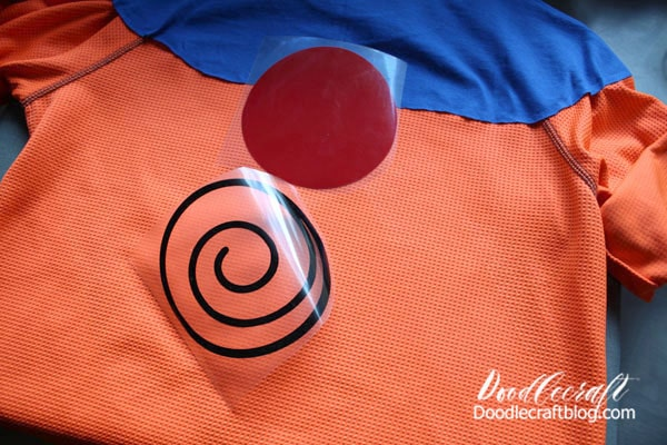 Naruto was created by cutting the top half of a blue t-shirt and sewing it right onto an orange shirt. Then applying the Uzumaki clan symbol...this red dot with black swirl.