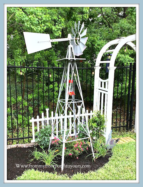 BackyardEnglish-country- Garden-white-picket-fence-arbor-windmill-day lilly-jasmine-salvia-roses-From My Front Porch To Yours