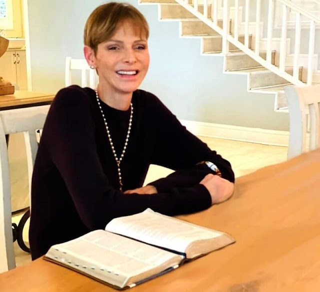 Princess Charlene shared a new photo showing her smiling as she sat at a table in front of an open book
