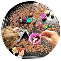 hot chocolate tuff tray with coco pops mini marshmallows and plastic cups