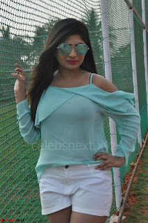 Madhulagna Das looks super cute in White Shorts and Transparent Top 02.JPG