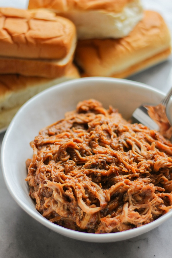Serve up these Spicy BBQ Pepper Pork Sandwiches for a fast and delicious weeknight meal! They are hearty and flavorful, and the slow cooker does all the work!