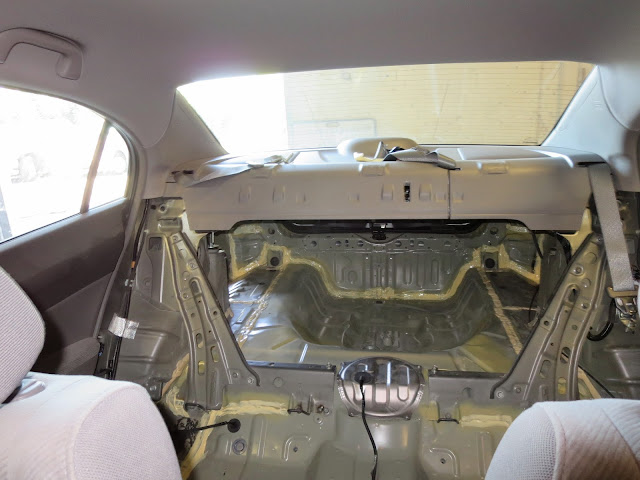 Interior of car looking from the driver's seat through to the trunk with new floor and rear installed.