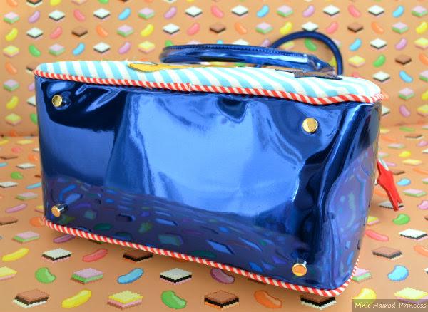 irregular choice whoa bag metallic blue base
