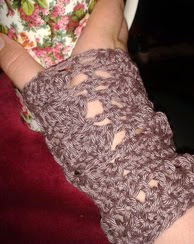 http://www.ravelry.com/patterns/library/esperaza-wrist-warmers