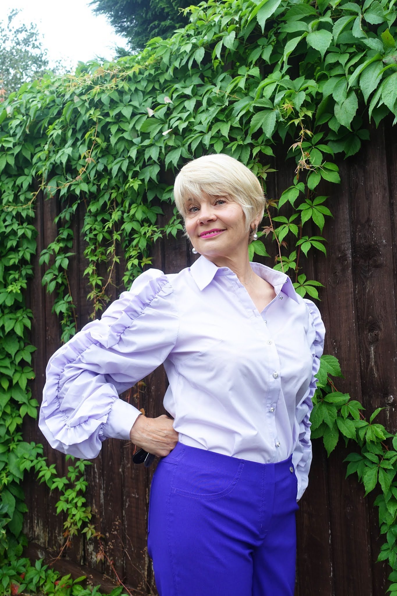 Gail Hanlon from Is This Mutton in lilac blouse with statement sleeves from River Island and purple trousers