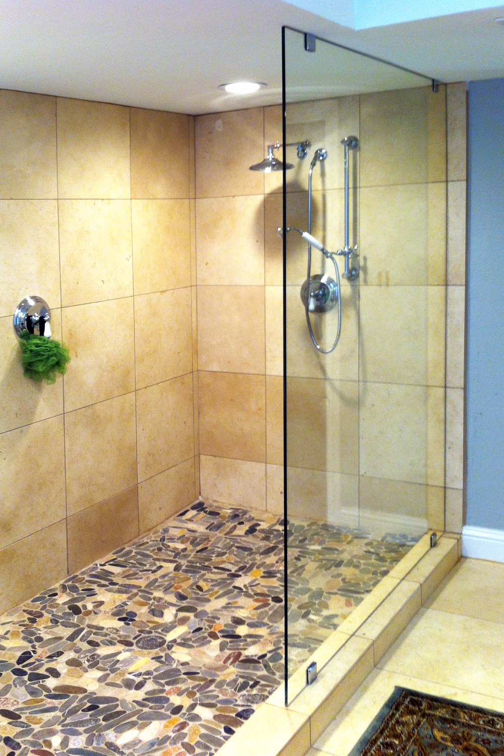 How to Change a Framed Shower Door to Frameless   Accent Bath and     You can get the look even if you don t have a separate shower  here  a  single pane of glass protects the bathroom from splashes  without any of the  visual