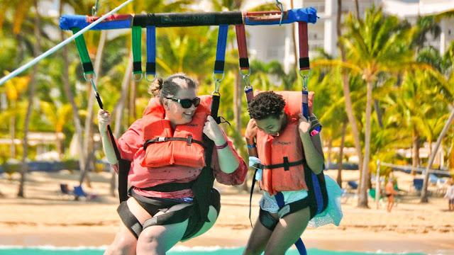 Kate and daughter parasailing at beach