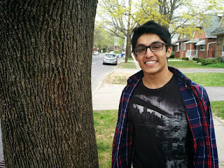 Harshal standing next to a street tree