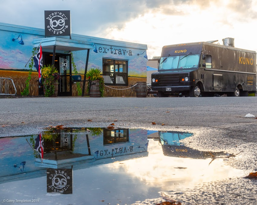 Portland, Maine USA September 2019 photo by Corey Templeton. The puddle from a passing storm outside of Brewery Extrava on Cove Street.