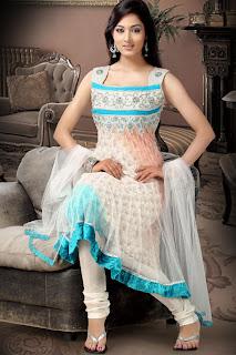a woman wearing a churidar white designer anarkali suit