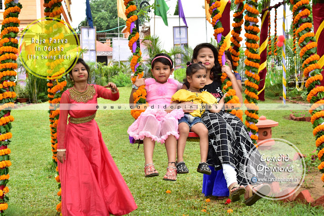 Young girls merrily indulge in swing rides