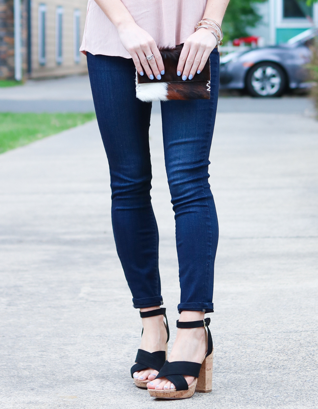 clutch with a dark skinny jean