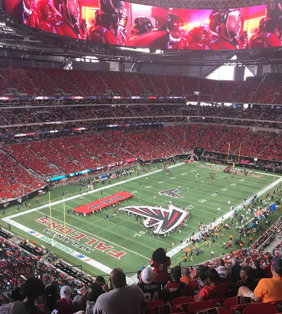 Atlanta Falcolns NFL Mercedes Benz Stadium Football Game