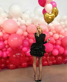 Organic balloon wall as a backdrop party decoration