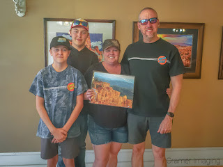 The Panguitch Art Gallery's first customers with their landscape photo purchase