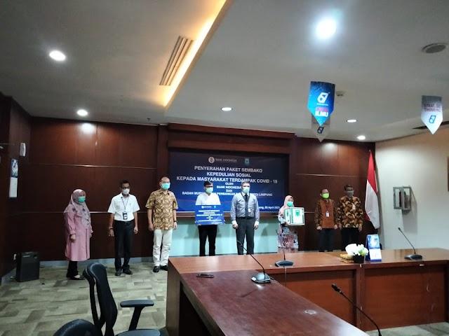 Bank Indonesia Lampung Bersinergi Dengan BMPD Bagikan Ribuan Sembako Kepada Masyarakat Terdampak Covid-19