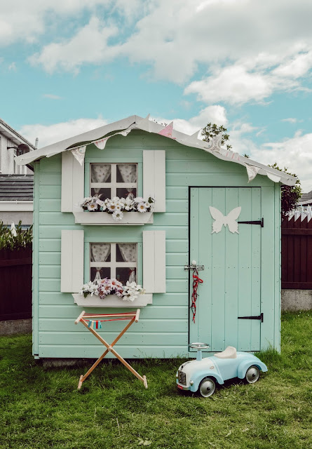 Shed turned into a cute shabby chic playhouse.