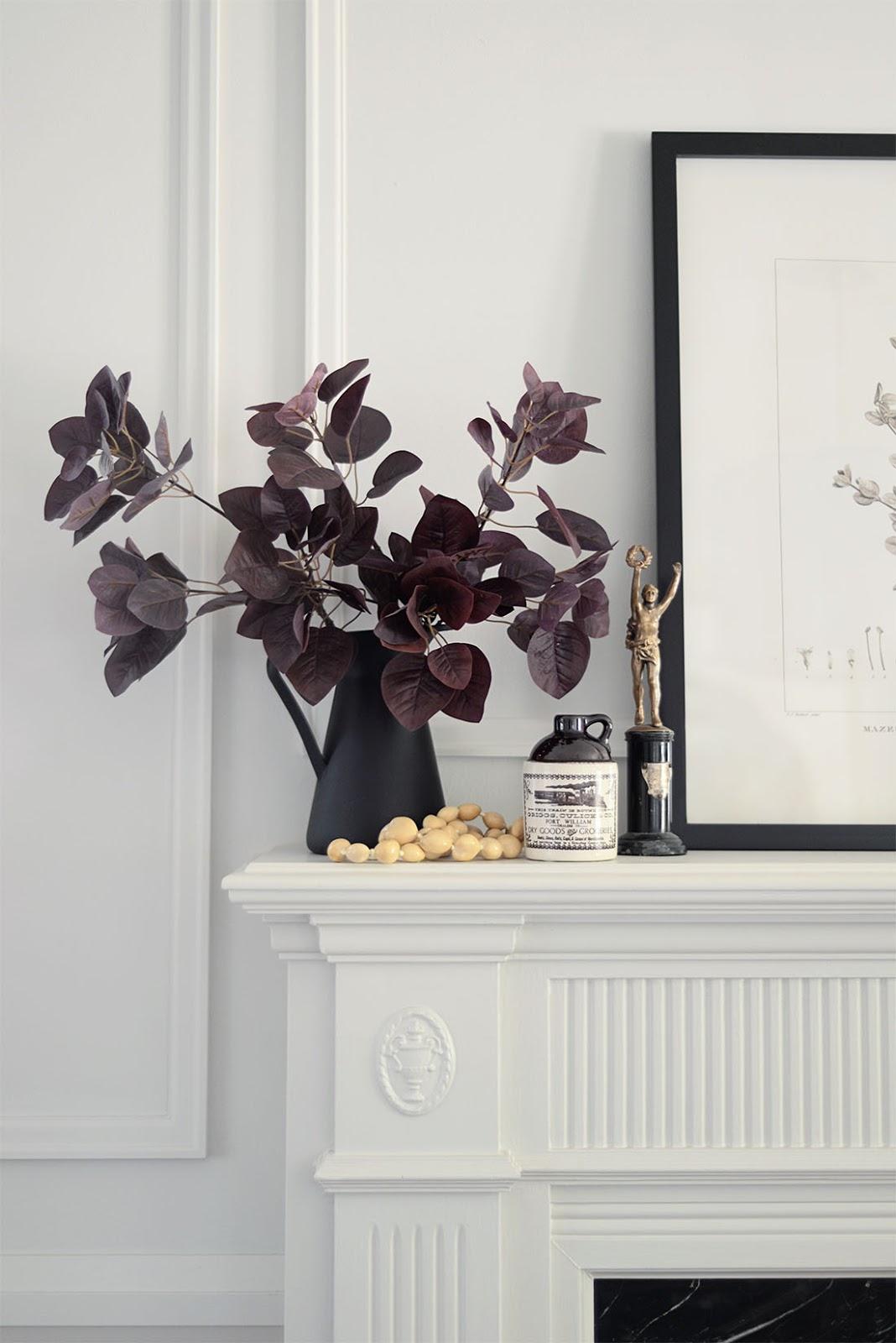 red leaf branch in vase, vintage trophy, art on mantel, mantel decor, fall living room