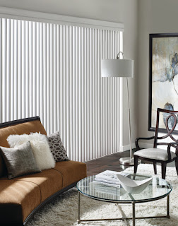 The curved vanes of Cadence Soft Verticals mimic soft drapery folds over a sliding glass door.