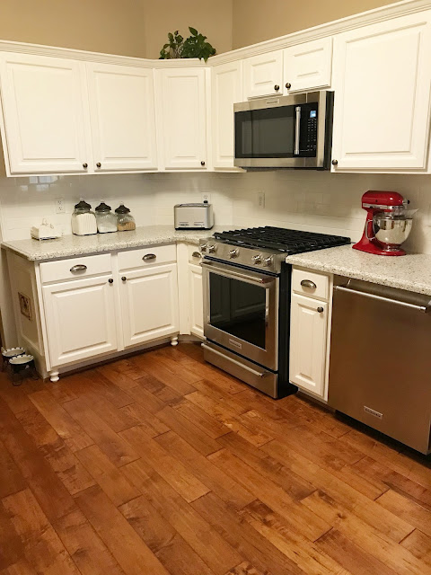 kitchenaid stainless appliances with red medallions