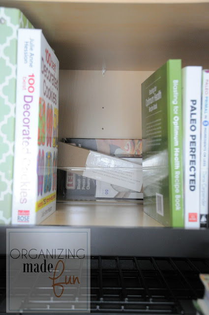 Organized cupboard over fridge for cookbooks and baking supplies :: OrganizingMadeFun.com