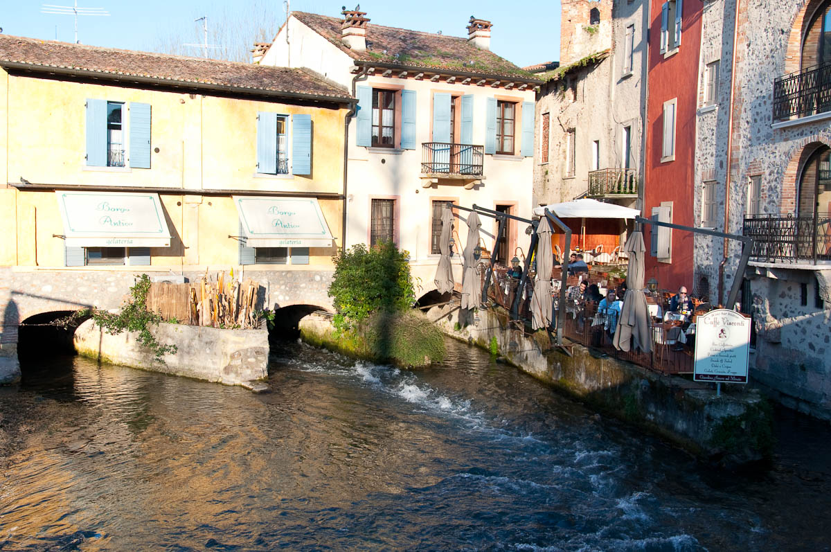 A cafe jutting in the river Mincio, Borghetto, Veneto, Italy