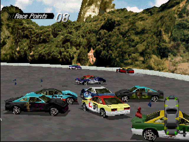 A scene from Destruction Derby wherein a series of cars are smashing into each other.