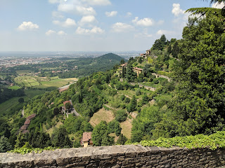 The sculpted hills behind Bergamo's Upper City.